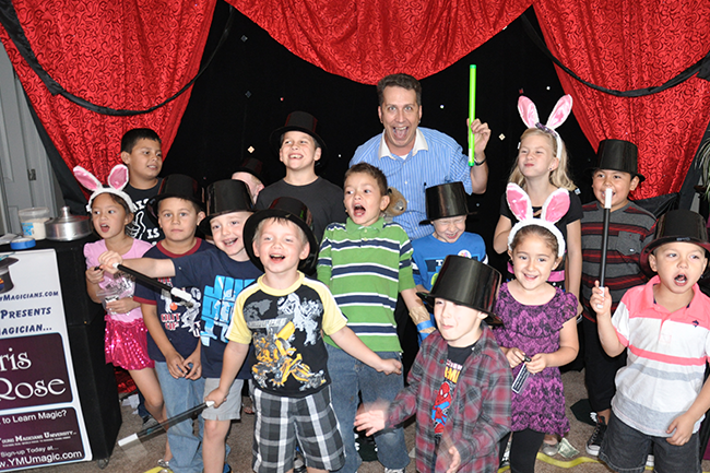 Birthday Party Magician in AZ, Chris Rose with a happy group of party goers
